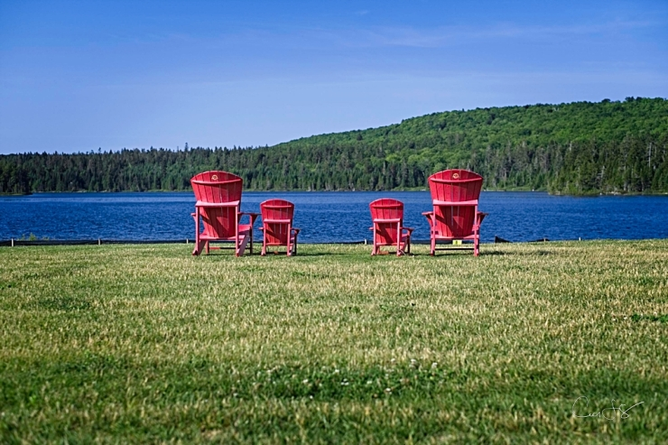 Red chairs overlooking Wolf Lake