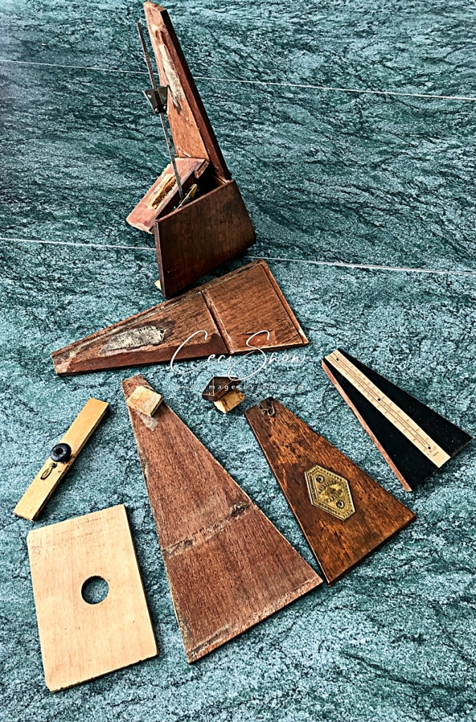 Antique wooden metronome shattered
